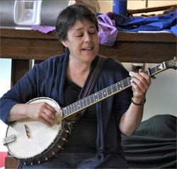 Lui playing banjo at a Hilltown Music Together class-photo by Debbie Lusignan